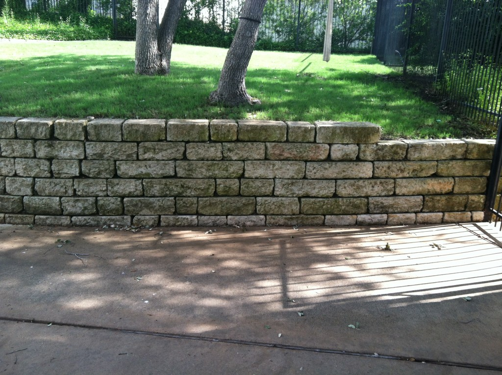 This wall could be washed with either method, but pressure washing would wash out dirt behind the stones.