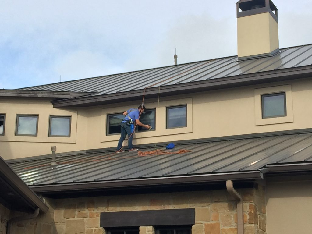 Safety while working on a roof sparkling clean window Sparkling image roof exterior cleaning